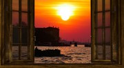 Venice at sunset through a window