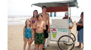 Cousins enjoying a copa (snowcone) on the beach