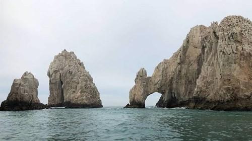 Take a boat tour of El Arco