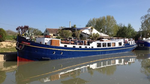 A Luxury Hotel Barge Moored in France