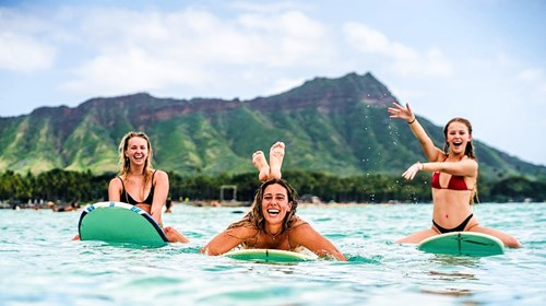 Surfing in front of Diamond Head Crater