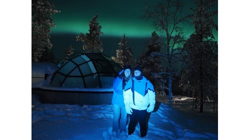 In awe of the northern lights from a glass igloo