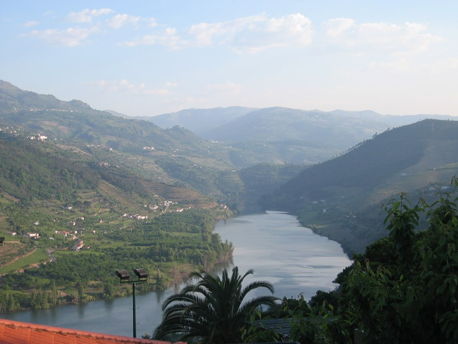 A hotel room with a view of the Douro River