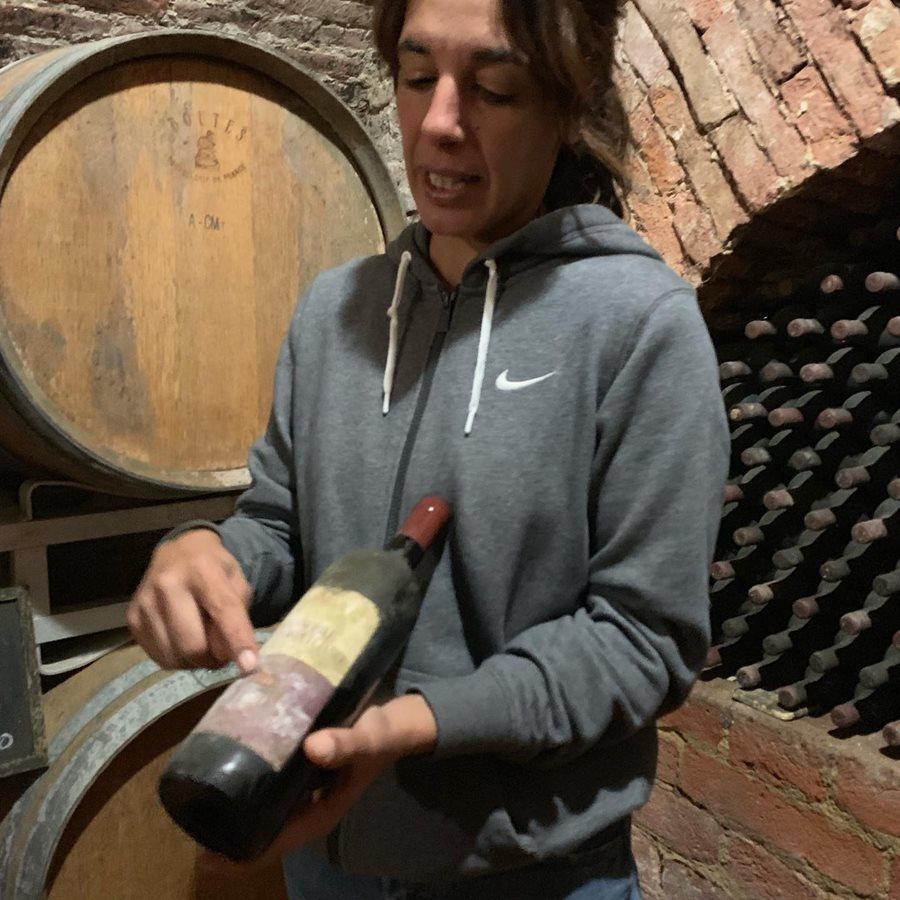 Winemaker showing us an old vintage!