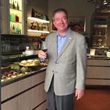 Enjoying a glass of wine in Cortona.