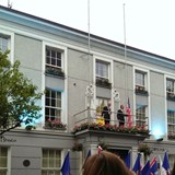 The town mayor present & past raised the flags