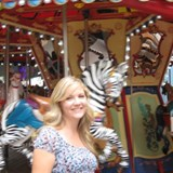 Jaime by the Carousel on the Oasis Boardwalk