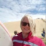 Sandboard down the dunes of the Aupouri Peninsula