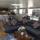 Comfortable main saloon on a canal barge