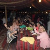 Traditional desert barbecue with belly dancing