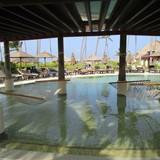 Relaxing pool hammocks at Secrets Royal Beach
