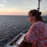 My wife is enjoying sunrise on last sea day.