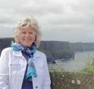 Carol at the Cliffs of Moher in Ireland