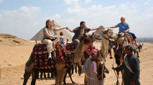 Riding Camels near the Egyptian Pyramids.