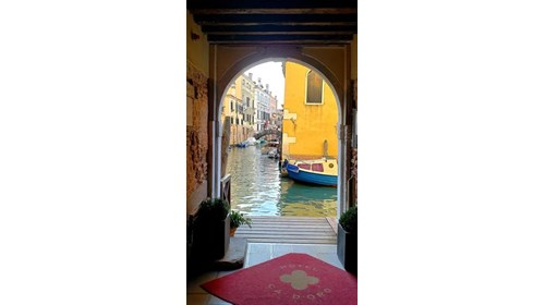 Stepping out of Hotel Ca Doro in Venice