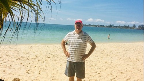 Richard Snelgrove on the beach in Cambodia
